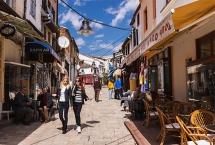 Young women walking through outdoor bars and restaurants at Carsija district-Old Bazaar in Skopje, Macedonia